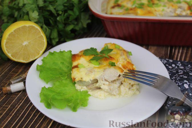 Фото к рецепту: Рыба, запечённая в молоке, с сыром