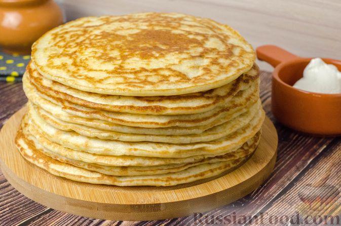 Фото к рецепту: Толстые дрожжевые блины на молоке, манке и пшённой каше