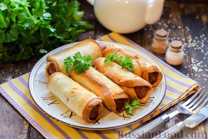 Фото к рецепту: Сосиски в тостовом хлебе (в духовке)
