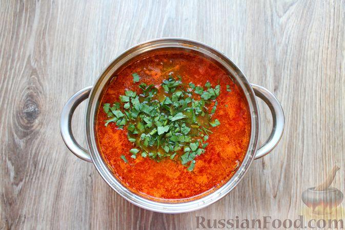 Фото приготовления рецепта: Рыбный суп с консервированными томатами - шаг №11