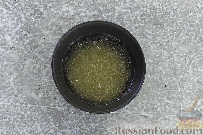 Фото приготовления рецепта: Торт из картофельно-миндального бисквита с вишнёвым конфитюром и белым ганашем - шаг №22