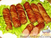 Фото к рецепту: Чевапчичи (жареные колбаски) в беконе