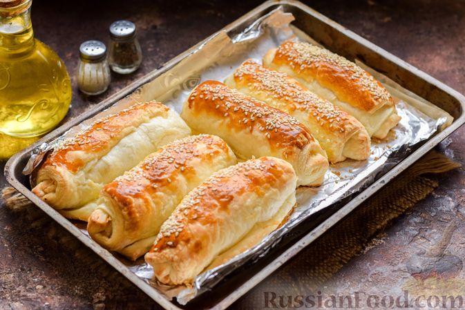 Фото приготовления рецепта: Слоёные рулетики с курицей - шаг №10
