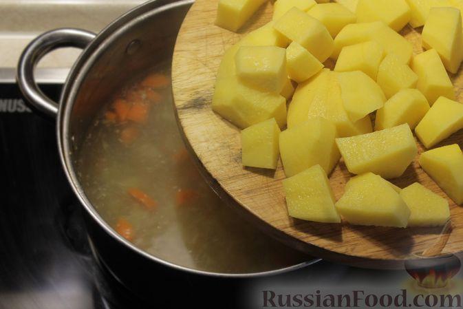 Фото приготовления рецепта: Рыбный суп с рисом - шаг №7