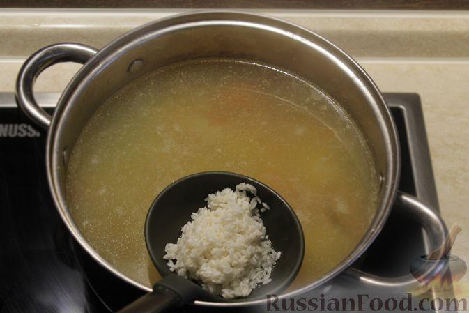 Фото приготовления рецепта: Рыбный суп с рисом - шаг №8