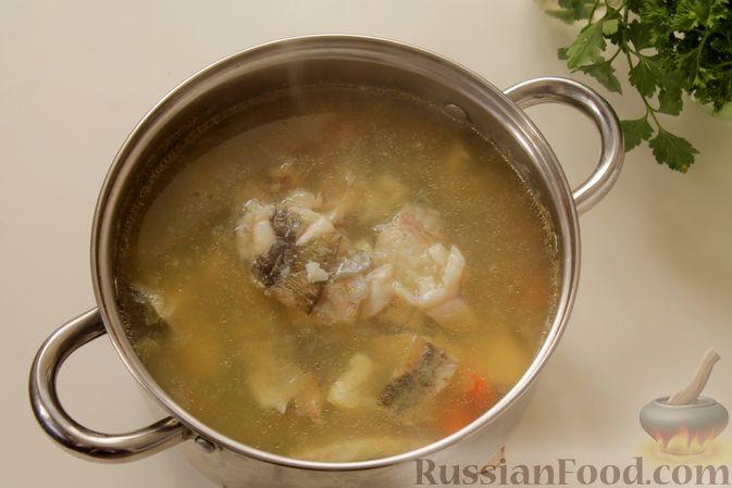 Фото приготовления рецепта: Рыбный суп с рисом - шаг №9