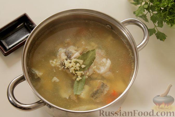 Фото приготовления рецепта: Рыбный суп с рисом - шаг №10