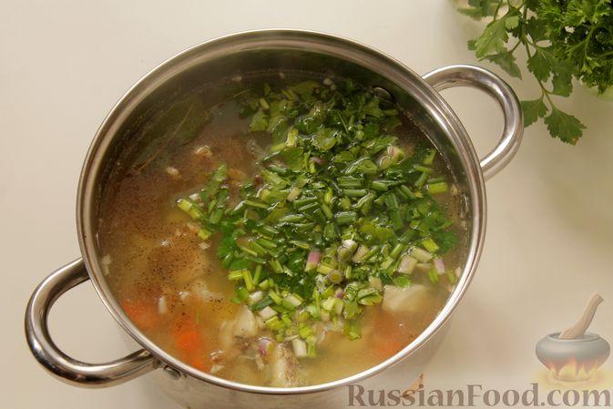 Фото приготовления рецепта: Рыбный суп с рисом - шаг №11