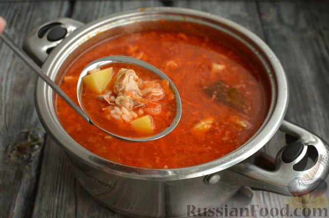 Фото приготовления рецепта: Томатный суп со свининой и рисом - шаг №15