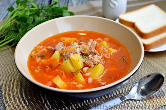 Фото приготовления рецепта: Томатный суп со свининой и рисом - шаг №16