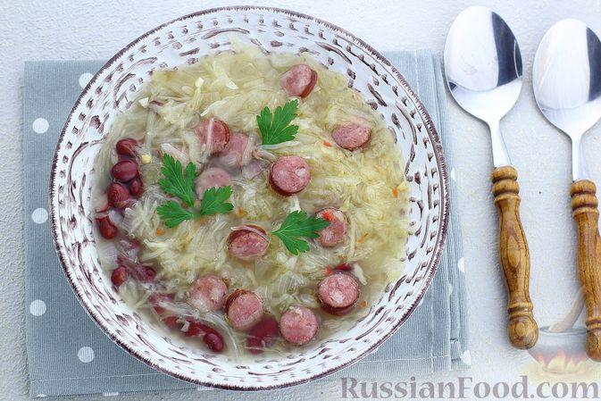 Фото приготовления рецепта: Суп с квашеной капустой, фасолью и охотничьими колбасками - шаг №19
