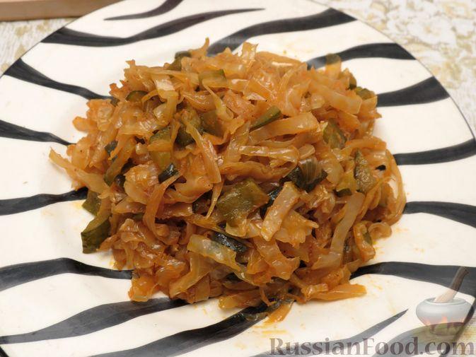 Фото к рецепту: Капуста, тушенная с солёными огурцами