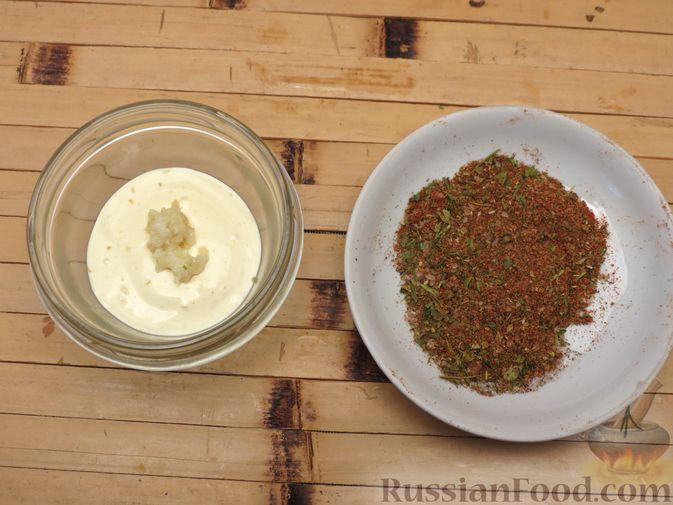 Фото приготовления рецепта: Куриные крылышки, запечённые с брокколи и тыквой - шаг №2