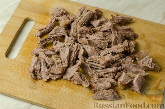 Фото приготовления рецепта: Щи из кислой капусты с говядиной - шаг №13