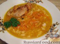 Фото к рецепту: Похлебка из кролика с рисом и кореньями