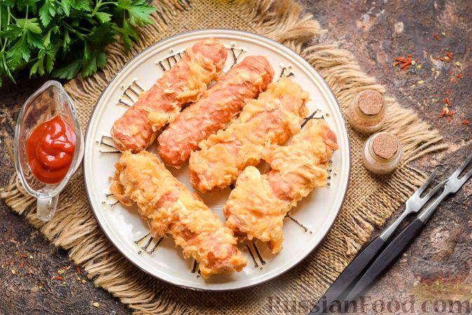 Фото изготовления рецепта: Сосиски в кляре, жаренные во фритюре - шаг №7