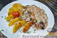 Фото к рецепту: Свинина в сливочно-грибном соусе