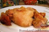 Фото к рецепту: Куриные бедрышки, запеченные с яблоками