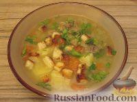 Фото к рецепту: Густой куриный суп с чесночными сухариками