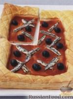 Фото к рецепту: Открытый пирог с анчоусами и оливками