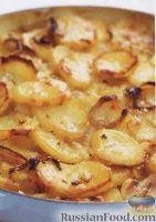 Фото к рецепту: Картофель, запеченный с луком и чесноком