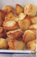 Фото к рецепту: Вкусная картошка, жаренная в духовке
