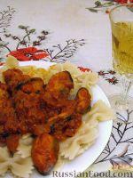 Фото к рецепту: Тушеные мидии в томатно-сливочном соусе, с фарфалле