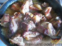 Фото к рецепту: Рeбрышки, тушенные в собственном соку