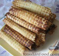 Фото к рецепту: Трубочки вафельные со сгущенкой