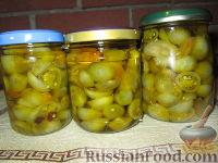 Фото к рецепту: Маринованные зеленые помидоры