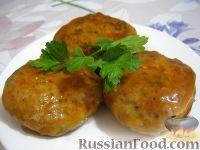 Фото к рецепту: Рыбные котлеты в томатной подливке
