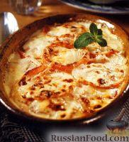 Фото к рецепту: Помидоры, запеченные в сливках под сырной корочкой