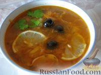 Фото к рецепту: Солянка с капустой, грибами и консервированной рыбой