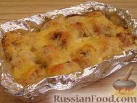 Фото к рецепту: Куриные тефтели, запеченные в сливочном соусе