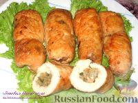 Фото к рецепту: Куриные рулеты с рисом и грибами
