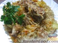 Фото к рецепту: Тушеная капуста с мясом и картофелем