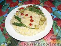 Фото к рецепту: Яичница рисовая с сыром и кусочками куриного филе