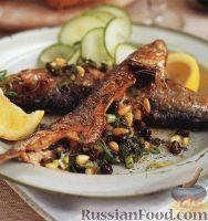 Фото к рецепту: Сардины, фаршированные смородиной, орешками и луком