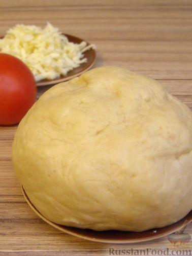Фото приготовления рецепта: Хлебный омлет с ветчиной, помидорами и сыром - шаг №11