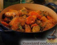 Фото к рецепту: Куриное мясо, тушенное с овощами в нежном соусе