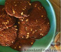 Фото к рецепту: Шоколадные блинчики с орешками