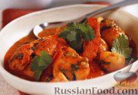 Фото к рецепту: Картофель, тушенный с креветками в остром томатном соусе