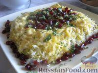 Фото к рецепту: Слоеный салат с грецкими орехами и гранатом
