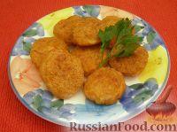 Фото к рецепту: Ароматные котлетки из курицы и сыра