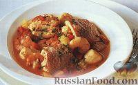 Фото к рецепту: Тушеные морепродукты