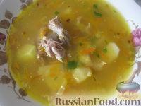 Фото к рецепту: Гороховый суп со свиными ребрышками