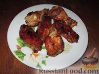 Фото к рецепту: Куриные крылышки в остром соусе