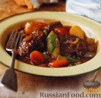 Фото к рецепту: Говядина с овощами, тушенная в духовке