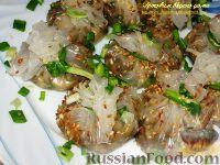 Фото к рецепту: Узелки из рисовой бумаги с грибами