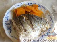 Фото к рецепту: Карп запеченный с лимоном и овощами